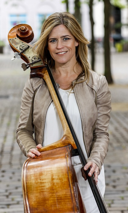 Kristin Korb holding her upright bass.